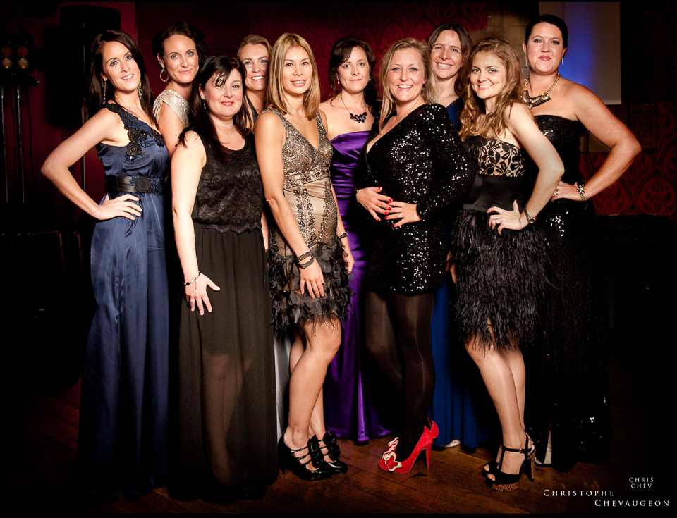 colour photograph of a group of women posing at a corporate event