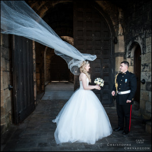 Bride's veil blowing in the wind at Alnwick Castle