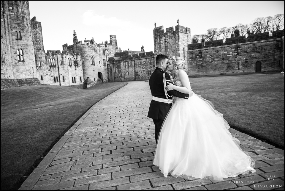 A wedding kiss on the grounds of Alnwick Castle