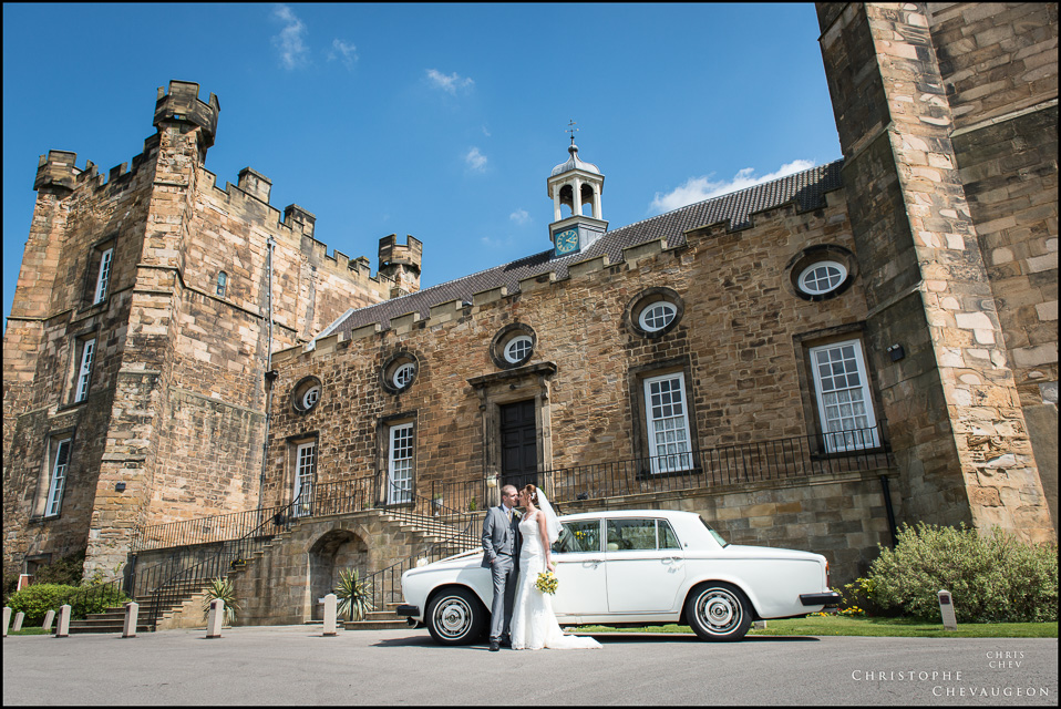 Bride and Groom in front of their car at Lumley Castle