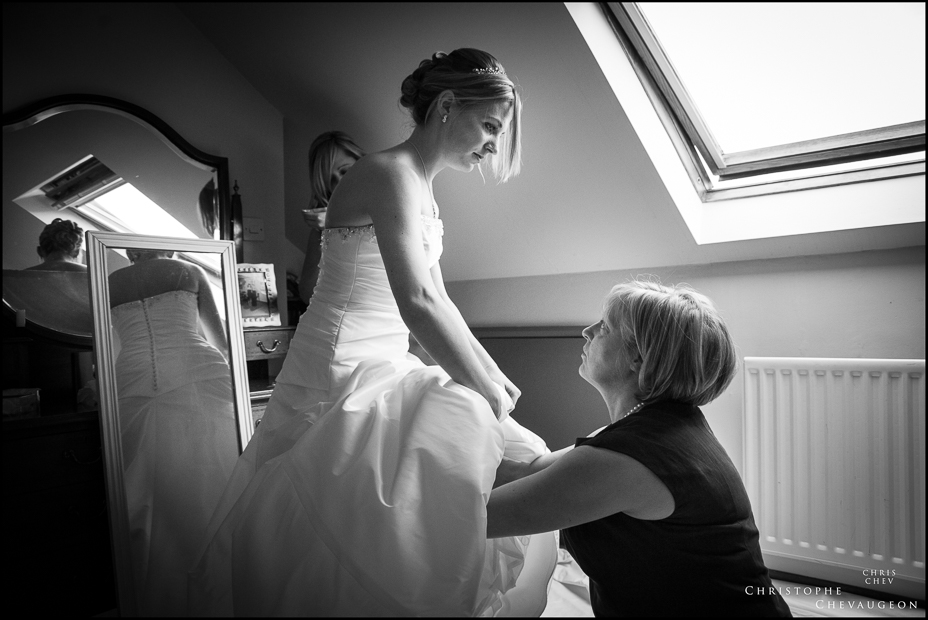 documentary wedding photography north east mother helping her dughter adjust her wedding dress