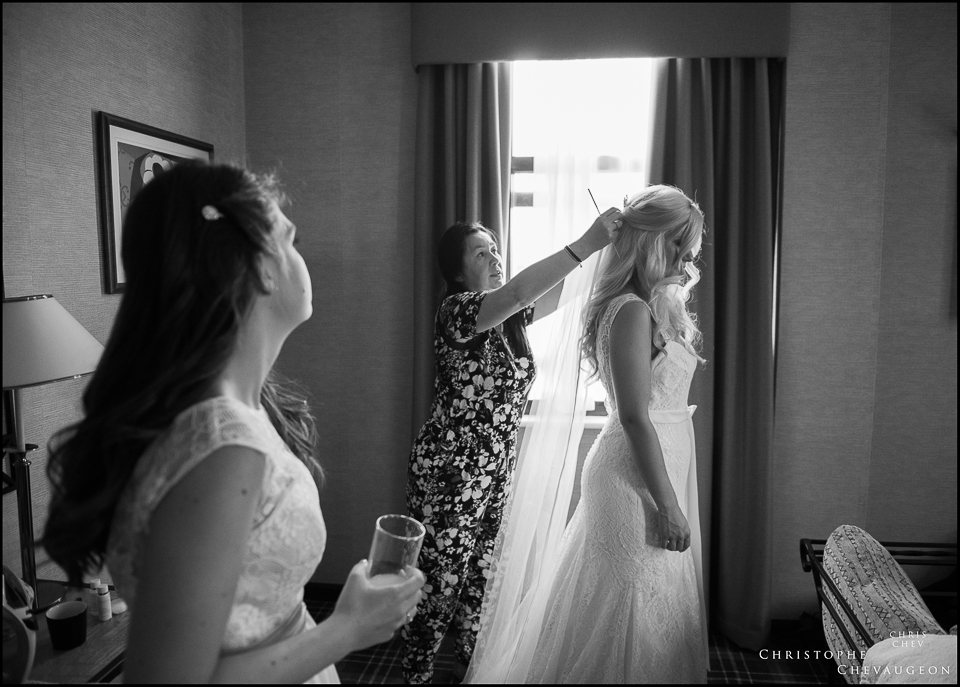 final touches to the Bride's hair in her room at the Vermont Hotel photographed by ChrisChevPhotographer
