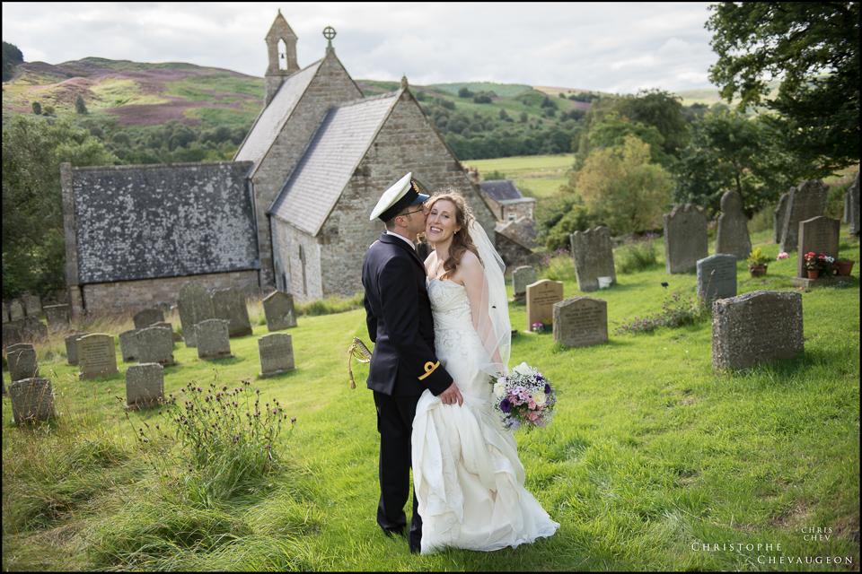 Northumberland wedding bride and groom outside of Alwinton church in Northumberland