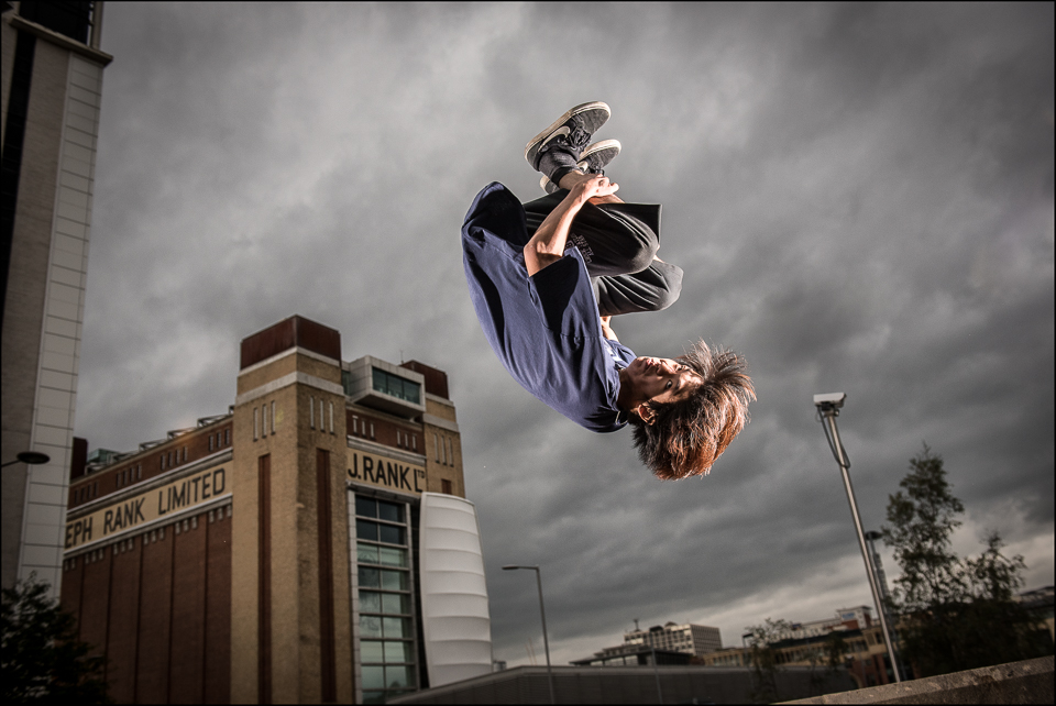 Free Runner and Parkour adept action Newcastle Up on Tyne behind the Baltic